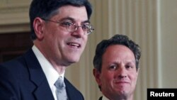 White House Chief of Staff Jack Lew (L) speaks alongside outgoing U.S. Treasury Secretary Timothy Geithner at the White House, January 10, 2013.