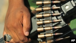 The ammunition of a rebel fighter is seen as he arrives at Green Square in the Kish, Benghazi July 6, 2011, from all the freed areas of Libya to demonstrate against Muammar Gaddafi and his regime.