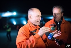 Solar Impulse 2 pilots Bertrand Piccard, left, and Andre Borschberg speak with reporters after their solar-powered plane landed at Moffett field in Mountain View, Calif., April 23, 2016.