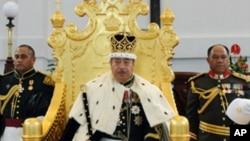 In this Aug. 1, 2008 photo, the King of Tonga, George Tupou V, sits on his throne in Nuku'aloka,Tonga.