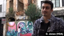 "Ulas, a local restaurant manager in Tophane, welcomes the rise of graffiti art. It is ""super,"" he says."