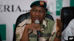 FILE - Brig. Gen. Chris Olukolade, Nigeria's top military spokesman, speaks during a press conference on the abducted school girls in Abuja, Nigeria, May 12, 2014.