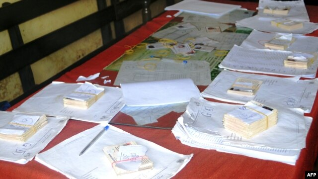 View of voter cards in Conakry on Sept. 26, 2013, on the last campaign day for Guinea's parliamentary elections.