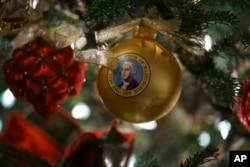 An ornament with an image of President George Washington is seen during the 2018 Christmas preview at the White House in Washington, Monday, Nov. 26, 2018. (AP Photo/Carolyn Kaster)