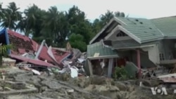 Indonesians Begin to Bury Victims of Quake, Tsunami Disaster