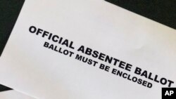 A Cobb County Ga., absentee ballot is seen Tuesday, May 5, 2020, in Kennesaw, Ga. Presidential Preference Primary, General Primary Election, Nonpartisan General Election, and Special Election will be held June 9, 2020.