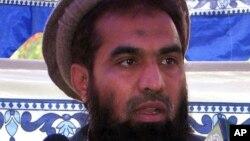 FILE - Pakistani Zaki-ur-Rehman Lakhvi speaks during a rally at Muzaffarabad, in Pakistani controlled Kashmir.