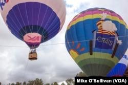 Balloons lifting off.