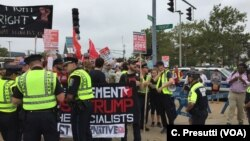 First clash with police - stopped counter-protestors because of picket signs