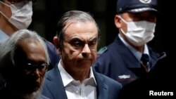 ormer Nissan Motor Chariman Carlos Ghosn leaves the Tokyo Detention House in Tokyo, Japan April 25, 2019.