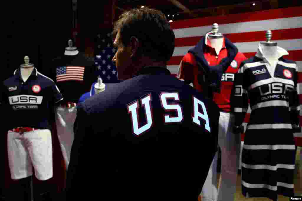 Cliff Meidl, two-time U.S. Olympic athlete, models the official Team USA Opening Ceremony flag-bearer outfit which will include special electroluminescent panels, at the Polo Ralph Lauren store in New York City.