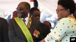 IN GOOD TIMES: President Robert Mugabe and Vice President Joice Mujuru.