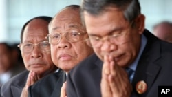 Chea Sim, center, president of the ruling Cambodian People's Party, Heng Samring, rear left, the party honorary president, Hun Sen, foreground, the party's vice president and the prime minister of the Cambodian government, file photo.