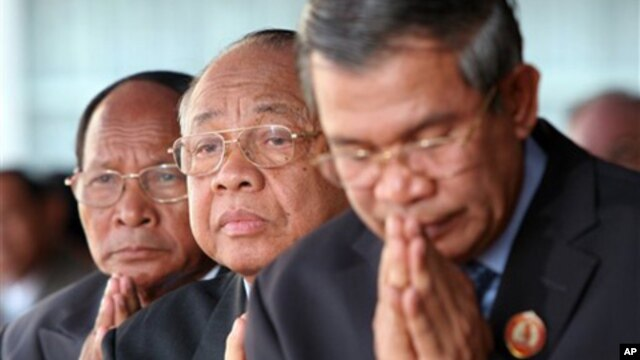 Chea Sim, center, president of the ruling Cambodian People's Party, Heng Samring, rear left, the party honorary president, Hun Sen, foreground, the party's vice president and the prime minister of the Cambodian government.
