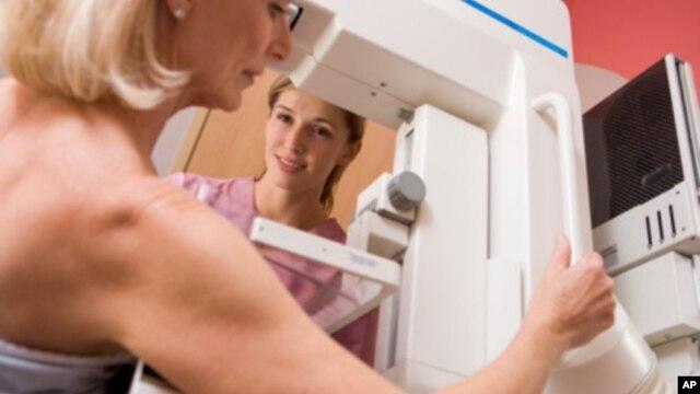 FILE -  A woman is seen undergoing a mammogram.