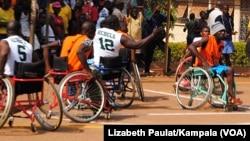 FILE: Disabled athletes play basketball as part of Uganda's Wheelchair Basketball Association.