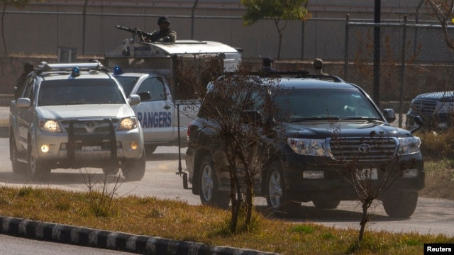 A black car carrying former Pakistani President Pervez Musharraf arrives at the Special Court formed to try him for treason in Islamabad, Feb. 18, 2014.