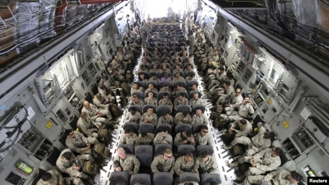 U.S. servicemen after boarding a transport plane before leaving for Afghanistan from the U.S. transit center at Manas airport, Bishkek, Kyrgyzstan, March 27, 2012.