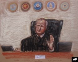 FILE - A Pentagon-approved sketch by court artist Janet Hamlin shows Army Col. James Pohl, the judge in proceeding, as he halts the Sept. 11 pretrial hearing at the Guantanamo Bay U.S. Naval Base in Cuba, April 17, 2014.