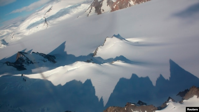 Jagged mountains throw long shadows on the Antarctic peninsula Jan. 20, 2009.