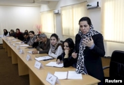 An Afghan woman speaks as they attend a class of the gender and women's studies masters program in Kabul University, Afghanistan on Oct. 19, 2015.