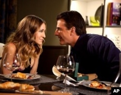 """SARAH JESSICA PARKER as Carrie Bradshaw, and CHRIS NOTH as Mr. Big in New Line Cinema's comedy """"SEX AND THE CITY 2,"""" a Warner Bros. Pictures release."""