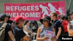 FILE - People gather for an anti-racism rally in downtown Toronto, Aug. 11, 2018. Canada announced Wednesday plans to increase deportations of immigrants in the country illegally.