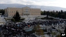 Supporters of the communist-affiliated union PAME gather outside the Greek Parliament during a protest in Athens, Dec. 8, 2016. Public services in Greece have been disrupted by a general strike called by unions against ongoing austerity measures.