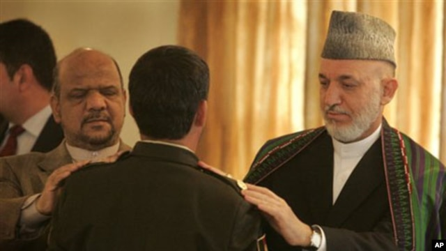 Afghan President Hamid Karzai, right, and first Vice President Muhammad Qasim Fahim, left, participate in a function promoting members of the Afghan security forces at the presidential palace in Kabul, 02 Oct 2010