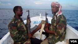 FILE - Somali pirates are shown in February 2012.