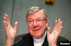 FILE - Cardinal George Pell talks during a news conference at the Vatican July 9, 2014.