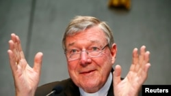 FILE - Cardinal George Pell talks during a news conference at the Vatican July 9, 2014. Australian Cardinal George Pell, too weak to travel to his homeland, testified Sunday from a hotel in Rome via a videolink to the Royal Commission into Institutional Responses to Child Sexual Abuse in Sydney.