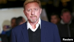 "FILE - Former tennis player Boris Becker poses for photographers at the world premiere of the film ""I am Bolt"" in London, Britain, Nov. 28, 2016."