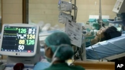 FILE - A hospital staffer monitors the vital signs of a suspected bird flu patient. Experts say the 3-D thread is a vast improvement over other biological diagnostic devices.