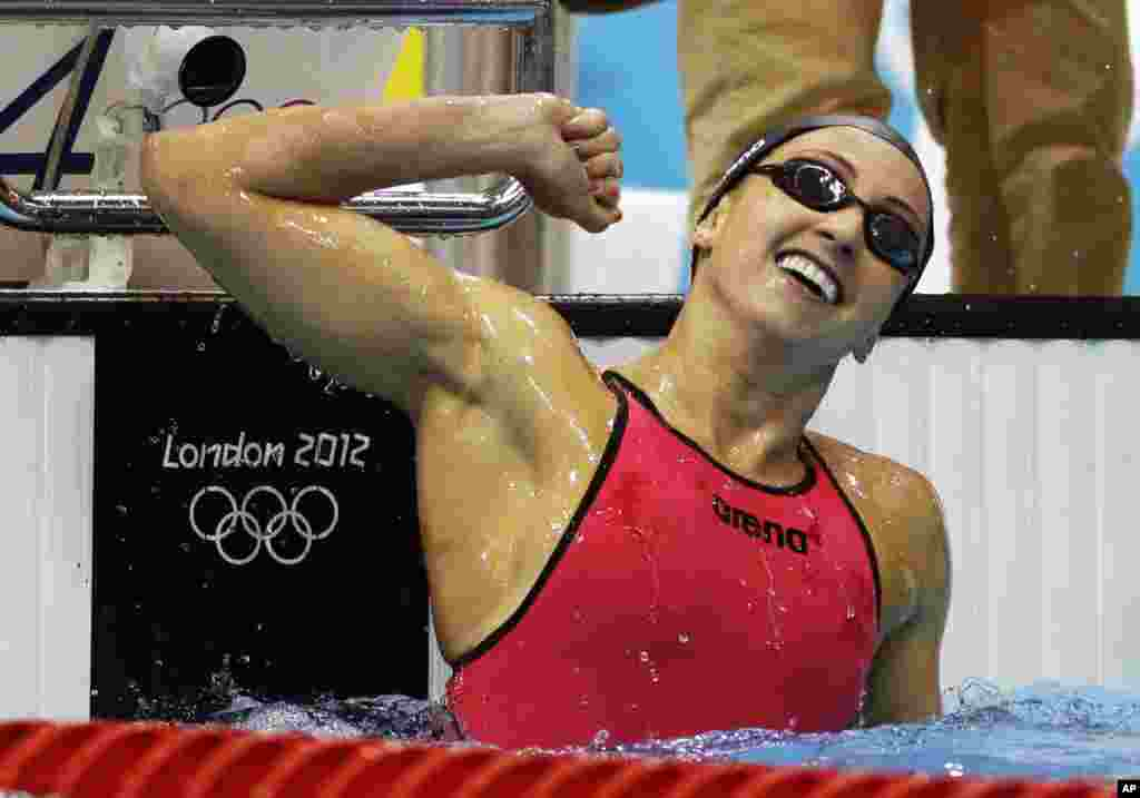 United States' Rebecca Soni celebrates winning gold and setting a new world record in the women's 200-meter breaststroke swimming final at the Aquatics Centre in the Olympic Park during the 2012 Summer Olympics in London, Aug. 2, 2012.