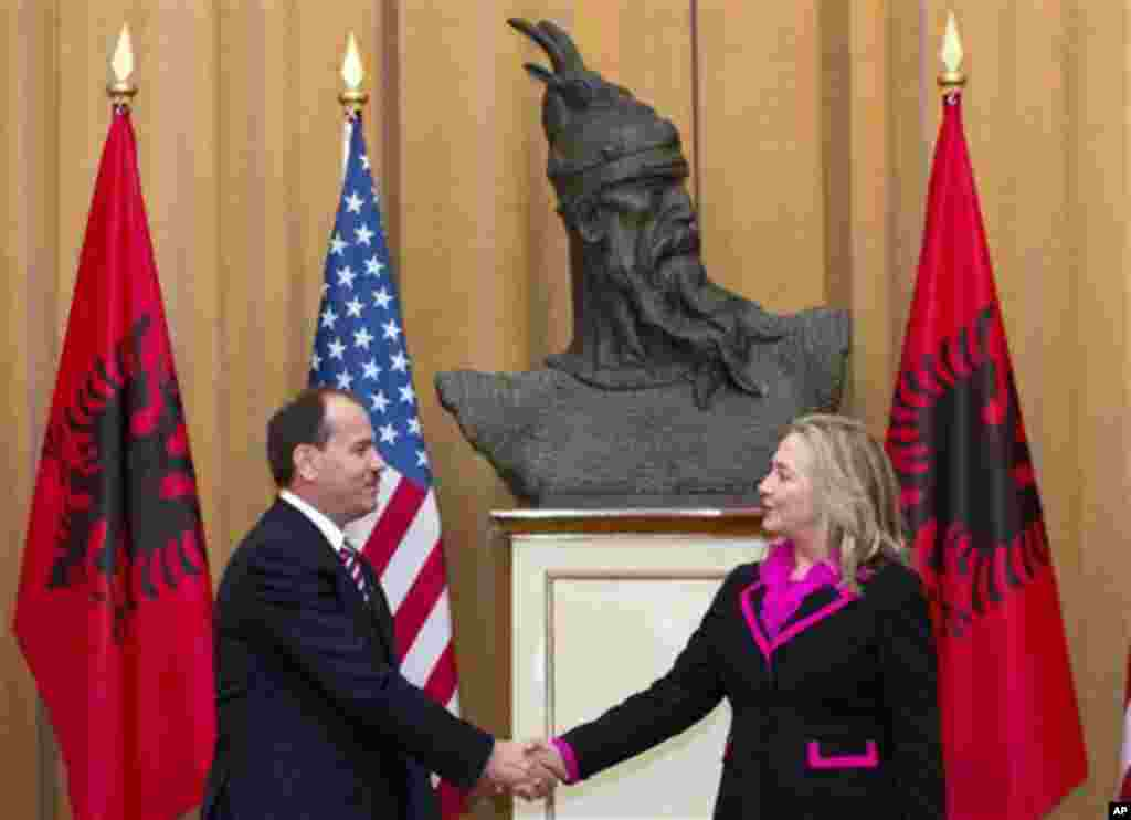 Albanian President Bujar Nishani and US Secretary of State Hillary Clinton shake hands following meetings at the Palace of the Brigades in Tirana, Albania, Thursday, Nov. 1, 2012. Hillary Clinton arrived in EU-hopeful Albania on the last leg of her Balkan