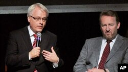 Ivo Josipovic, the current President of Croatia, (L) sits with Bakir Izetbegovic, a member of the Presidency of Bosnia and Herzegovina on a panel hosted by the Clinton Foundation to recognize the 15-year anniversary of the Dayton accords, February 9, 2011