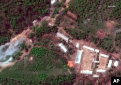 FILE - This May 23, 2018, satellite file image provided by DigitalGlobe, shows the Punggye-ri test site in North Korea.