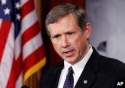 FILE - Sen. Mark Kirk, R-Ill., talks to the media on Capitol Hill in Washington.