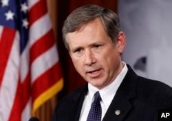 FILE - Sen. Mark Kirk, R-Ill., talks to the media on Capitol Hill in Washington.