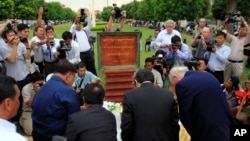 Cambodian and foreigner reporters pay respects during a ground-breaking ceremony for a memorial to journalists killed during the Cambodian conflict, south of Phnom Penh, file photo.