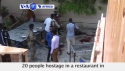 VOA60 Africa- 29 people killed after IS car bombing and hotel gun attack in Mogadishu
