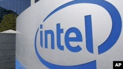 FILE - The Intel Corp. company logo is displayed at its headquarters in Santa Clara, California, Sept. 5, 2006.