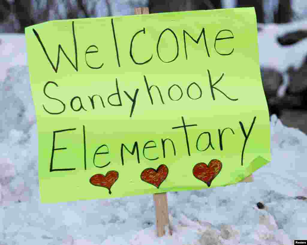 Signs of support are seen along the road between Newtown and Monroe, where the kids from Sandy Hook Elementary will begin to attend classes in Monroe, Connecticut, January 2, 2013.