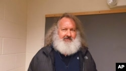 In a photo provided by the Vermont State Police, actor Randy Quaid stands in the Vermont State Police barracks in St. Albans, Vt., Friday, Oct. 9, 2015.