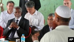 FILE - Former United Nations Secretary-General Kofi Annan, second left, listens to a Rohingya religious and community leader in the Internally Displaced People's camps during a visit by the Rakhine Advisory Commission in Thetkabyin village, outside Sittwe, the capital of Rakhine state in Myanmar, Sept. 27, 2016.