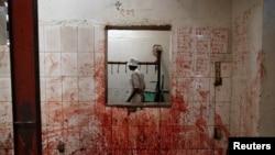 An employee works at a slaughterhouse near Nairobi, Kenya, Aug. 25, 2017.