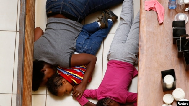 A mother and her children hide from gunmen at the Westgate mall in Nairobi Sept. 21, 2013. (Reuters)