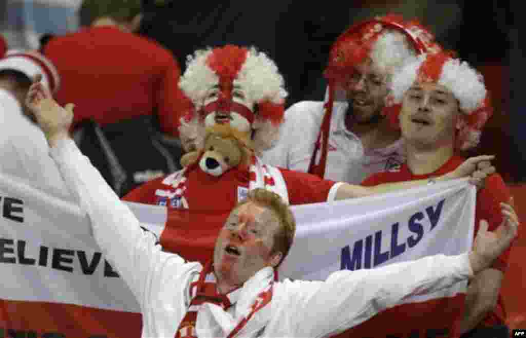 England fans celebrate winning the World Cup group C soccer match between Slovenia and England at Nelson Mandela Bay Stadium in Port Elizabeth, South Africa, Wednesday, June 23, 2010. England won 1-0 and advances to the round of 16. (AP Photo/Julie Jacobs