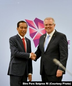 Presiden Joko Widodo dan Perdana Menteri Australia Scott Morrison bertemu di KTT ASEAN 2018 di Singapura, Rabu, 14 November 2018 (Foto: Biro Pers Setpres RI)